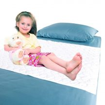 Waterproof bedding overlay with girl sitting on bed