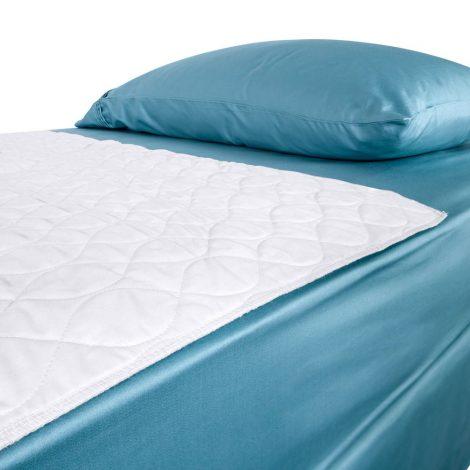 Waterproof bedding overlay on top of bed view